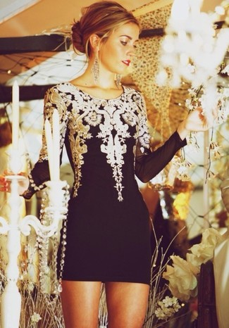 Go for a black embroidered cocktail dress to feel confidently and look fashionably.