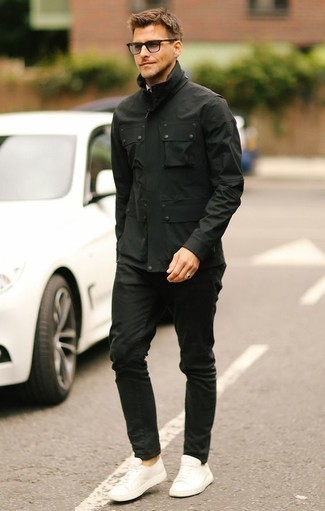 How to Wear Black Jeans For Men: Breathe personality into your day-to-day off-duty lineup with a black field jacket and black jeans. If in doubt about the footwear, introduce white leather low top sneakers to this ensemble.