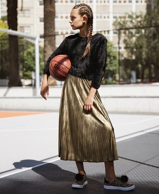 Look stylish yet practical in a New Look women's Tiered Sleeve Knit Sweater and a gold pleated midi skirt. A pair of tan leopard low top sneakers will be a welcome addition to your look. Nothing like a neat getup to spice up a dreary autumn afternoon.