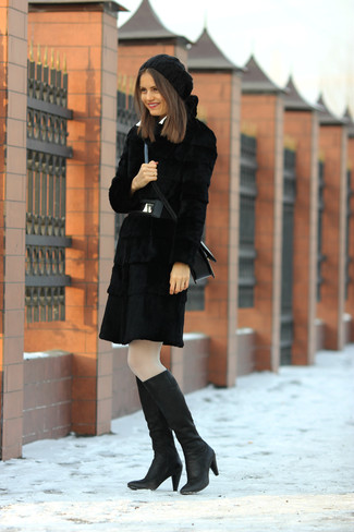 Reach for a black fur coat and you'll look stunning anywhere anytime. Black leather knee high boots will contrast beautifully against the rest of the look.