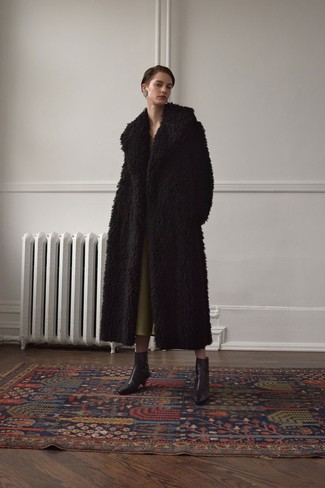 How to wear: black fur coat, olive midi dress, black leather ankle boots