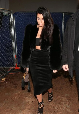 Kim Kardashian wearing Black Fur Jacket, Black Cropped Top, Black Midi Skirt, Black Suede Heeled Sandals