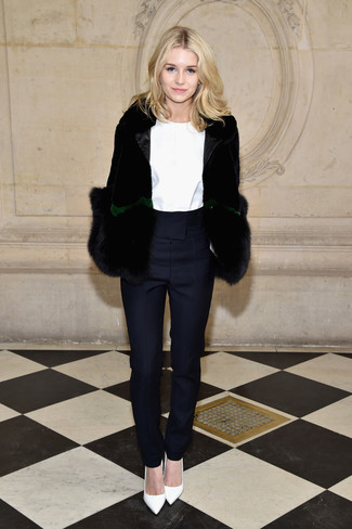 Women's Outfits 2020: For something on the classier end, wear this pairing of a black fur jacket and navy tapered pants. This look is completed wonderfully with white leather pumps.
