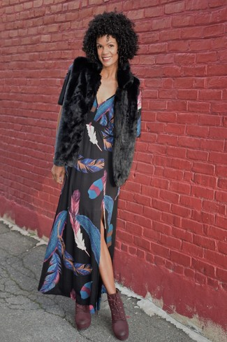 How to wear: black fur vest, black print maxi dress, burgundy leather lace-up ankle boots