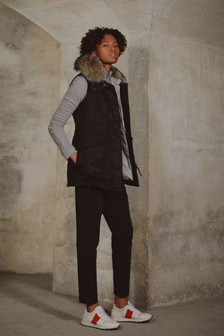 A gilet and black chinos are a great outfit formula to have in your arsenal. Opt for a pair of white athletic shoes for a more relaxed feel. This look is the definition of perfect for those warmer springtime days.