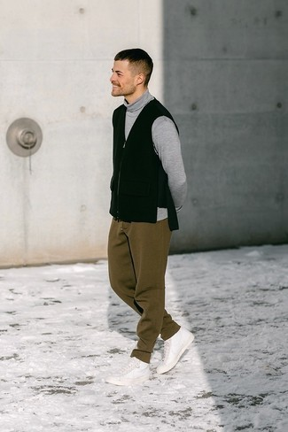 Black Gilet Outfits For Men: This combination of a black gilet and brown sweatpants is ideal for most casual situations. Avoid looking overdressed by rounding off with white leather high top sneakers.