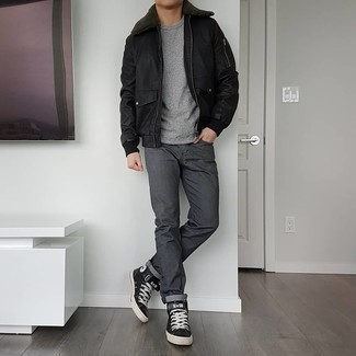 Charcoal Jeans Outfits For Men: Look awesome without trying too hard in a black leather harrington jacket and charcoal jeans. Puzzled as to how to finish? Complete your getup with a pair of black and white leather high top sneakers for a more laid-back finish.