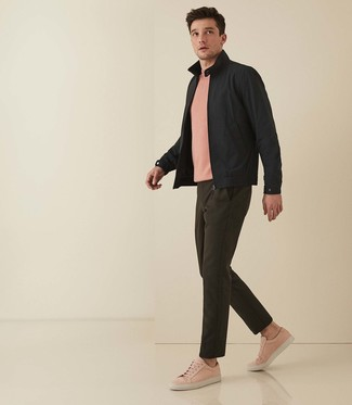 How to wear: black harrington jacket, pink crew-neck t-shirt, olive chinos, pink leather low top sneakers