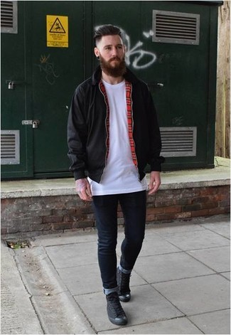 How to wear: black harrington jacket, white crew-neck t-shirt, navy skinny jeans, black canvas high top sneakers