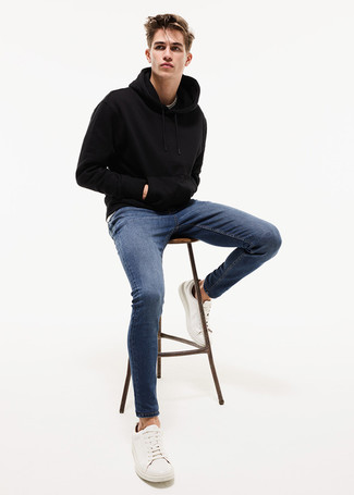 How to wear: black hoodie, blue skinny jeans, white leather low top sneakers