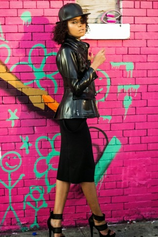 Perfect the smart casual look in a black leather jacket and a black midi skirt. This outfit is complemented perfectly with black studded suede heeled sandals.