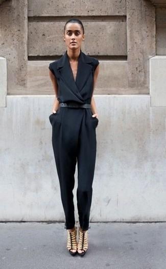 How to wear: black jumpsuit, beige leather gladiator sandals, black leather belt