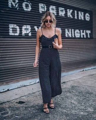 How to wear: black polka dot jumpsuit, black leather gladiator sandals, tan leather clutch, black sunglasses