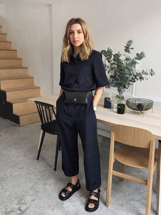 How to wear: black jumpsuit, black leather flat sandals, black leather fanny pack