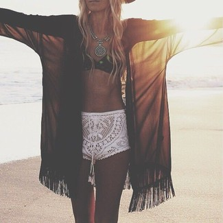 This combo of a black kimono and white crochet shorts is a safe bet for an effortlessly cool look.