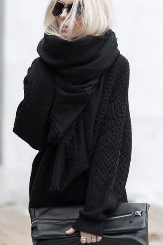 How to Wear a Black Scarf In a Relaxed Way For Women: For an edgy and casual look, consider wearing a black knit oversized sweater and a black scarf — these two items go really well together.