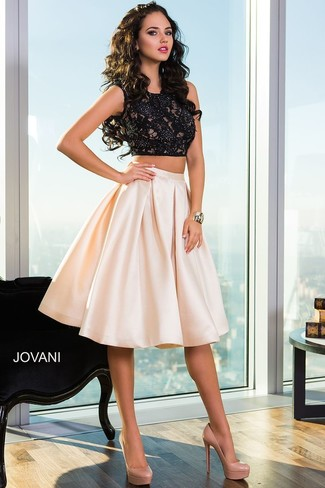 Pairing a black lace cropped top with a pale pink full skirt is a comfortable option for running errands in the city. Opt for a pair of camel leather pumps to instantly up the chic factor of any outfit.