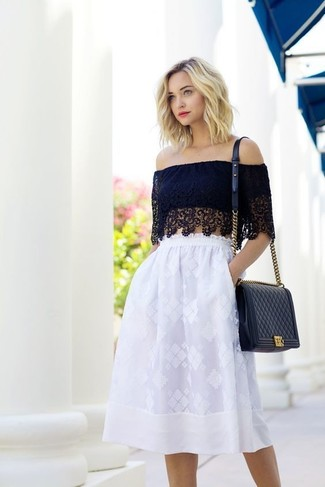 A black lace cropped top and a white lace full skirt will give off this very sexy and chic vibe.