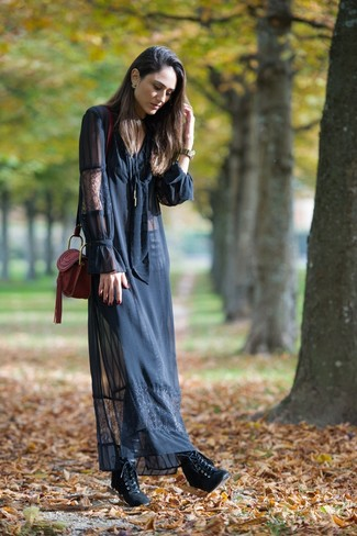 How to wear: black lace maxi dress, black leather lace-up ankle boots, burgundy leather crossbody bag