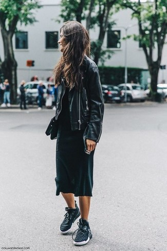 To create an outfit for lunch with friends at the weekend dress in a black leather moto jacket and a black maxi dress. A pair of black trainers brings the dressed-down touch to the ensemble.