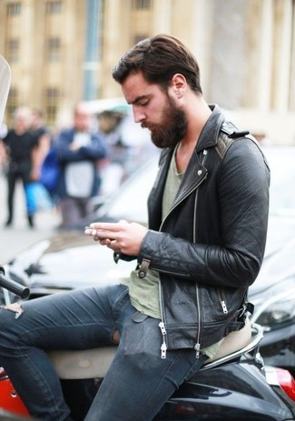 Pairing a black leather biker jacket with navy ripped skinny jeans is an amazing pick for a laid-back ensemble.