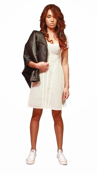 This combo of a black leather biker jacket and a white casual dress gives off a very casual and approachable vibe. A pair of white low top sneakers will seamlessly integrate within a variety of outfits.