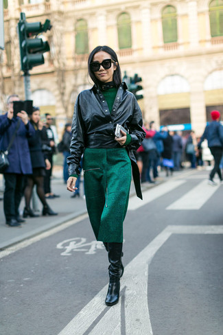 Pairing a black leather jacket with a hunter green midi dress is a  comfortable option for