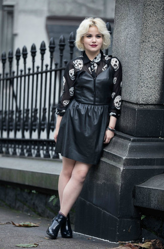 How to wear: black leather tank dress, black and white print chiffon dress shirt, black leather ankle boots