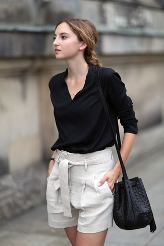 How to wear: black long sleeve blouse, beige linen shorts, black leather bucket bag