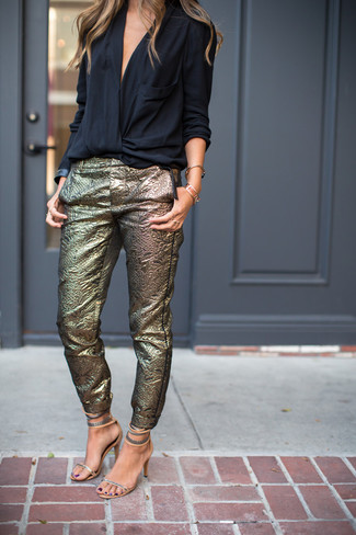 How to wear: black long sleeve blouse, gold skinny pants, silver leather heeled sandals