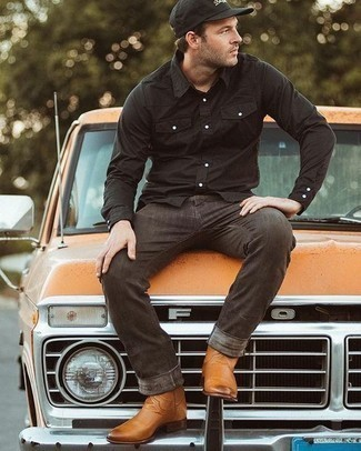 How to Wear a Black Long Sleeve Shirt For Men: Make a black long sleeve shirt and dark brown jeans your outfit choice for both dapper and easy-to-create getup. Tobacco leather chelsea boots will effortlessly lift up your look.