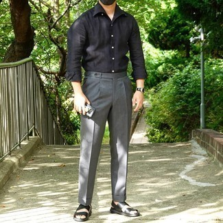 Black Long Sleeve Shirt Outfits For Men: This combination of a black long sleeve shirt and grey dress pants is a never-failing option when you need to look like a real gent. For something more on the daring side to complete your outfit, introduce a pair of black leather sandals to the equation.
