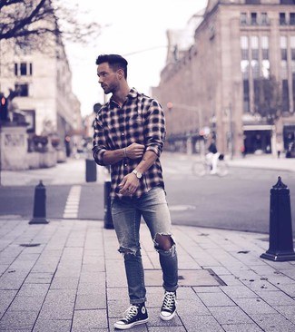 How to Wear a Black Plaid Long Sleeve Shirt For Men: A black plaid long sleeve shirt and grey ripped jeans are a laid-back combo that every fashionable gentleman should have in his off-duty collection. When it comes to shoes, this look pairs nicely with black and white canvas high top sneakers.