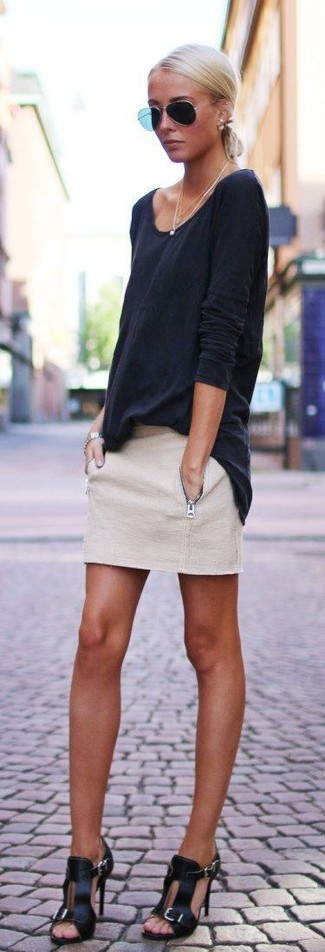 This combo of a black long sleeve t-shirt and a beige mini skirt is perfect for off-duty occasions. Rock a pair of Dune London Ivanna Lace Up Block Heel Sandal to va-va-voom your outfit. This here is proof that one actually can survive the sweltering heat and look easy breezy while doing so.
