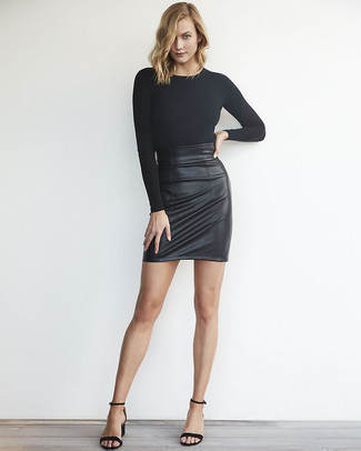 Black Long Sleeve T-shirt Outfits For Women: This combo of a black long sleeve t-shirt and a black leather mini skirt is indisputable proof that a safe casual ensemble can still be really interesting. A pair of black leather heeled sandals easily amps up the wow factor of this getup.