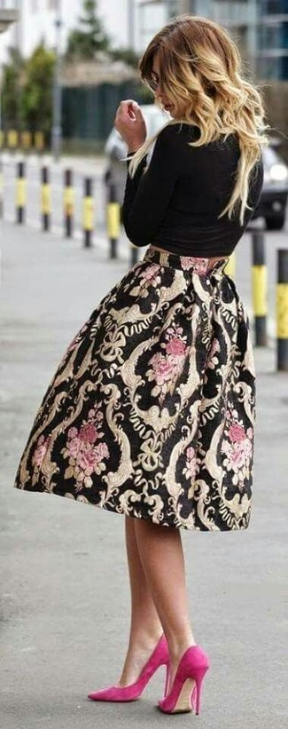 If it's comfort and functionality that you're seeking in an outfit, consider teaming a black long sleeve t-shirt with a black print full skirt. Play down the casualness of your outfit with hot pink suede pumps. We're loving that this combo is great when warmer days are here.