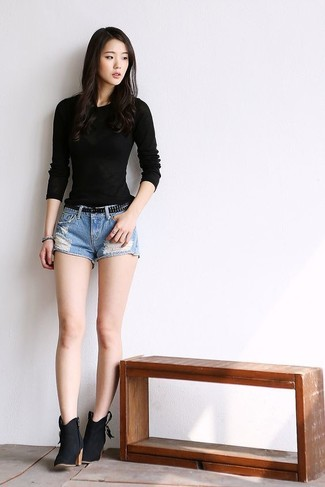Black Long Sleeve T-shirt Outfits For Women: A black long sleeve t-shirt and light blue ripped denim shorts are a go-to combination for many sartorially savvy ladies. For a more refined finish, why not complete this ensemble with black suede ankle boots?
