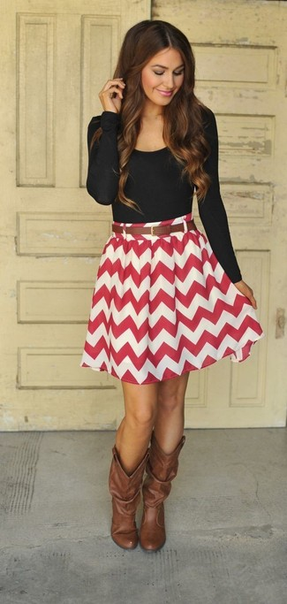 Wear a black long sleeve t-shirt with a red chevron skater skirt for both chic and easy-to-wear look. Brown leather knee high boots will bring a classic aesthetic to the ensemble.