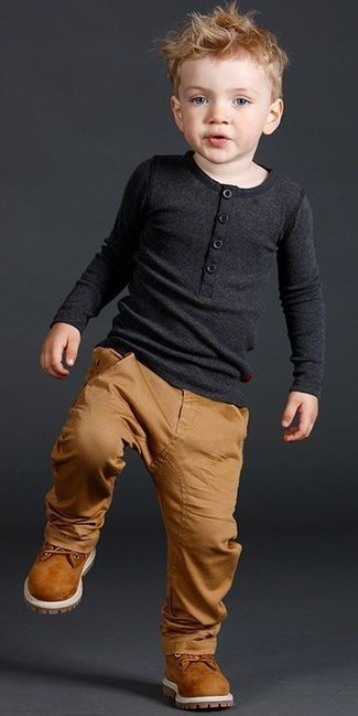 How to Wear Tan Trousers In Warm Weather Smart Casually For Boys: Suggest that your munchkin opt for a black long sleeve t-shirt and tan trousers for a comfortable outfit that's also put together nicely. As far as footwear is concerned, suggest that your boy throw in a pair of tobacco boots.