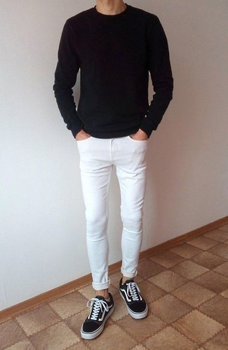 How to Wear a Black Long Sleeve T-Shirt For Men: A black long sleeve t-shirt and white skinny jeans are amazing menswear must-haves to incorporate into your day-to-day fashion mix. A pair of black and white canvas low top sneakers will create a stylish contrast against the rest of the ensemble.
