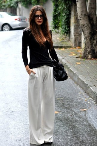 Black Long Sleeve T-shirt Outfits For Women: This combination of a black long sleeve t-shirt and white wide leg pants provides comfort and efficiency and helps keep it low profile yet modern. If you're hesitant about how to finish off, a pair of black leather pumps is a surefire option.