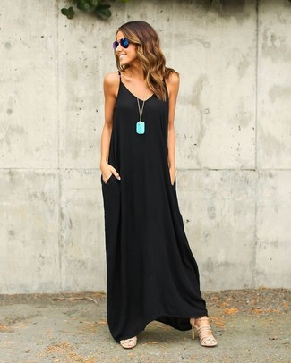 How to wear: black maxi dress, beige leather heeled sandals, blue sunglasses, aquamarine pendant