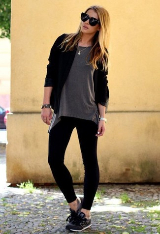 A black open cardigan and black leggings will convey a carefree, cool-girl vibe. Dress down this getup with black athletic shoes.