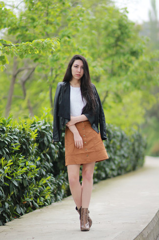 How to wear: black fringe leather open jacket, white crochet sleeveless top, tan button skirt, brown snake leather ankle boots