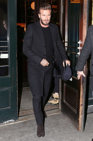 David Beckham wearing Black Overcoat, Black Crew-neck Sweater, Black Dress Pants, Dark Brown Suede Chelsea Boots