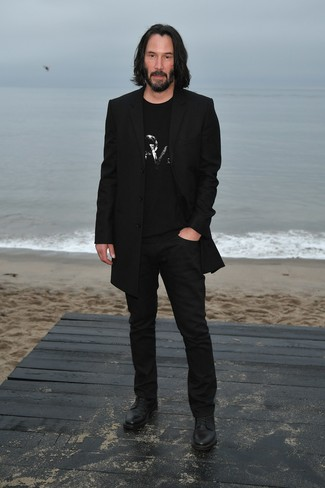 How to wear: black overcoat, black embellished crew-neck t-shirt, black chinos, black leather derby shoes