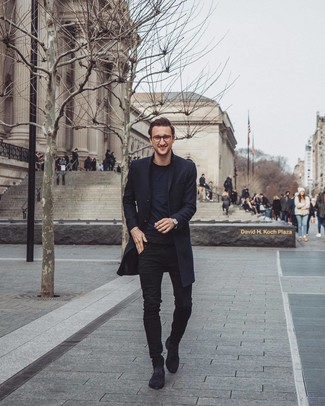 How to wear: black overcoat, black crew-neck t-shirt, black skinny jeans, black suede chelsea boots