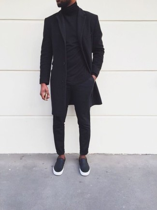 How to wear: black overcoat, black turtleneck, black chinos, black leather slip-on sneakers