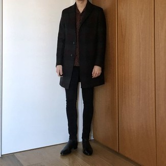 Black Skinny Jeans Outfits For Men: Choose a black overcoat and black skinny jeans and you'll look like the dapperest dude around. For a more elegant aesthetic, complete your ensemble with black leather chelsea boots.