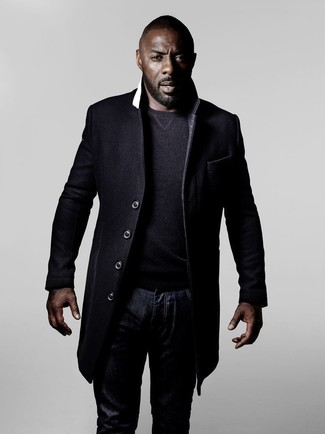 Idris Elba wearing Black Overcoat, Charcoal Crew-neck Sweater, Navy Jeans